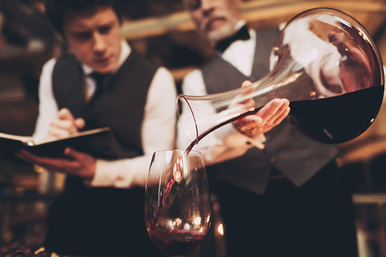 Close up. Two experienced sommeliers tas