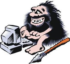 Caveman Sitting at Computer