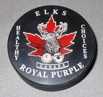 Elks and Royal Purple Hockey  Puck