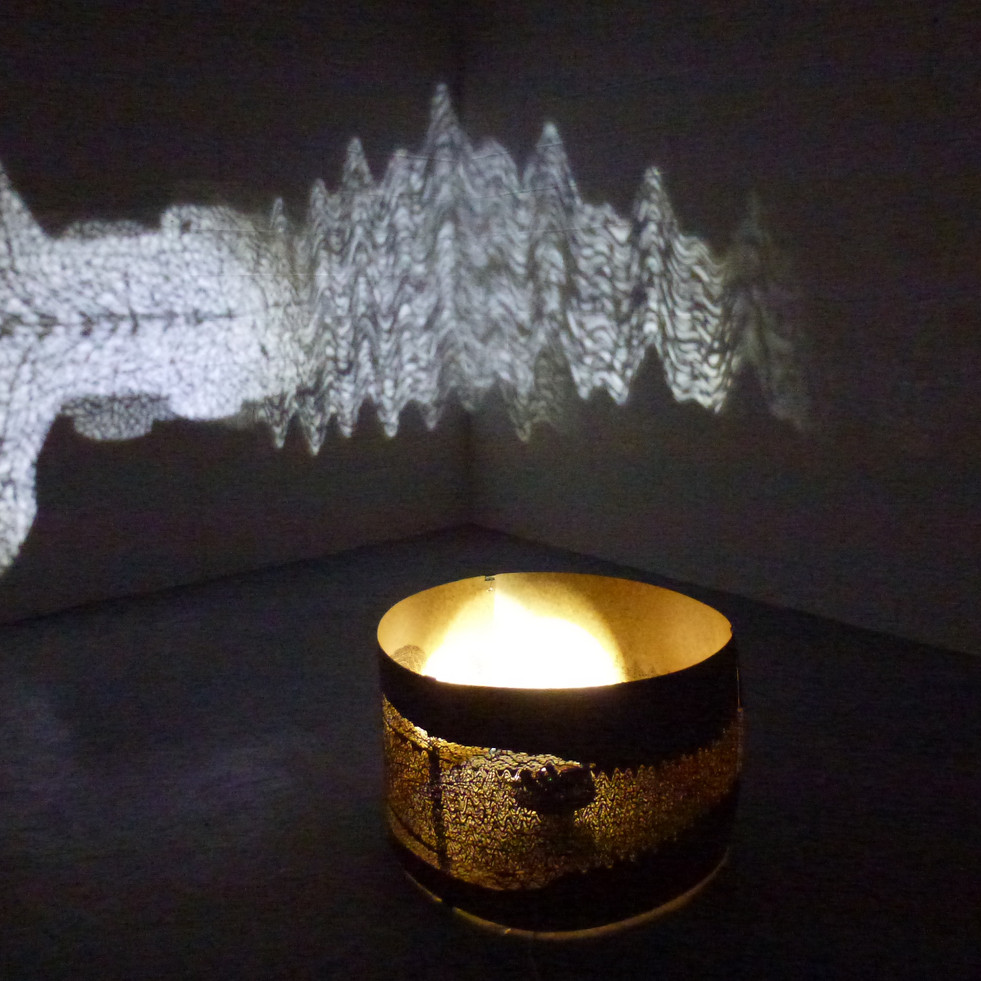 """Andrew Carnie , """"Rhythm"""" 2017, laser cut stencil card, rotating motor and torches, dimensions variable"""