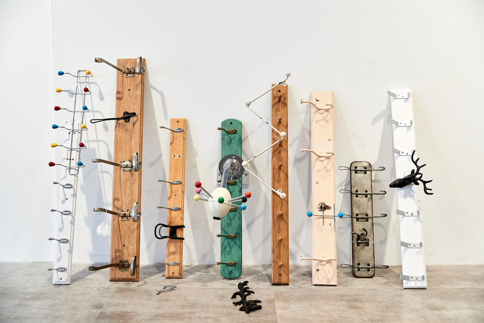 """Andrew Carnie, """"Gone Looking"""", 2019, coat hooks & wooden boards, size variable"""