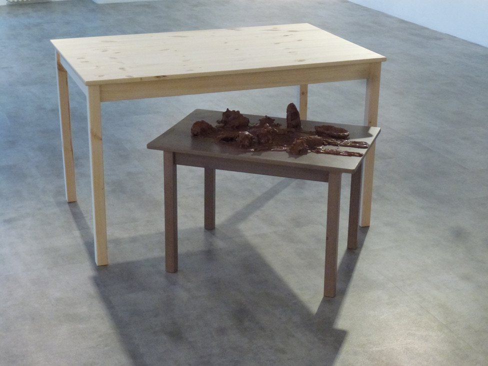 """Andrew Carnie, """"Present Just"""", 2019, chocolate over resin casts, two tables, size variable"""