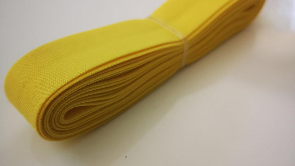 Biais de mercerie jaune en polycoton .