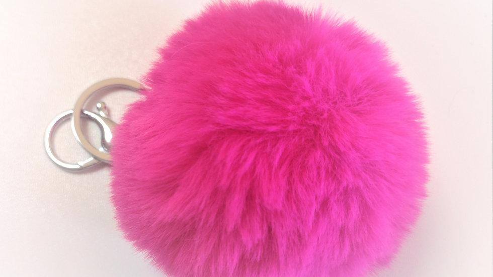 pompon porte clef rose fluo
