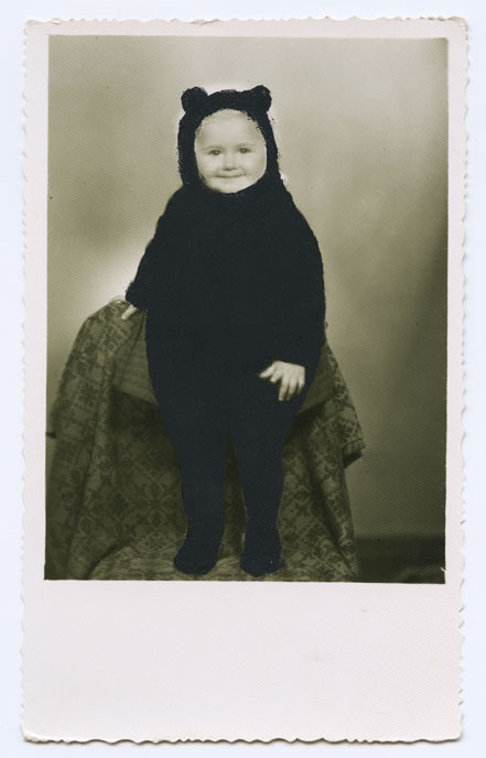 An early photo of my mother, she's no more than two years old here, wearing a sort of a warm black jumpsuit with small funny ears.
