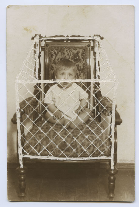 My first photo. I'm 10 months old or so, I'm standing in my baby crib behind a safety net. Everything is blurred and barely visible, just like my memories are.
