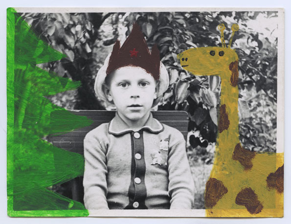 """This picture was taken in late autumn, the leaves have fallen from the trees, I'm dressed very warmly – a brown jacket and a """"budyonovka"""" hat. I'm hugging an inflatable giraffe among the fir trees near the clinic that I used to visit far too often in my childhood."""