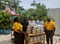 Staff of Tillie's Restaurant, flanked by Community Services Assistant Director Hall and Mr. Hall, pa
