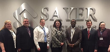Employees of Sayer Law Group with the mayor of Waterloo