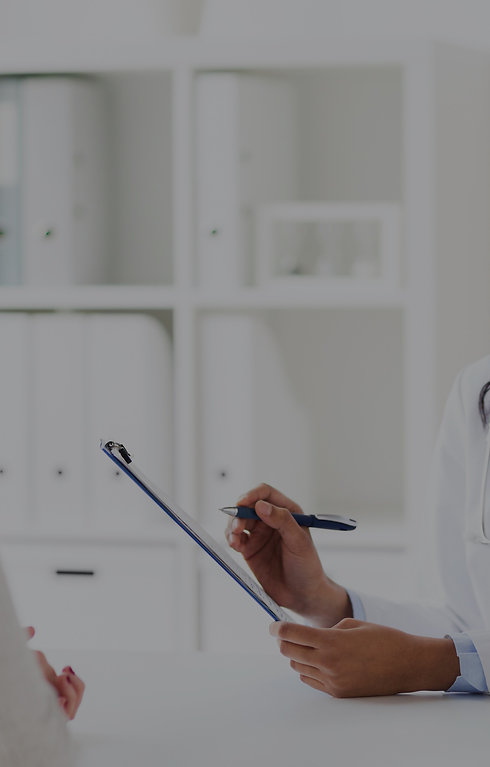 doctor-with-clipboard-and-woman-at-hospital-PFP5A87-r2_edited.jpg