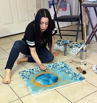 art by diana castillo, custom paintings, solar eclipse paintings, el paso art, el paso artists, solar eclipse, woman painting, paint brushes, butterflies,