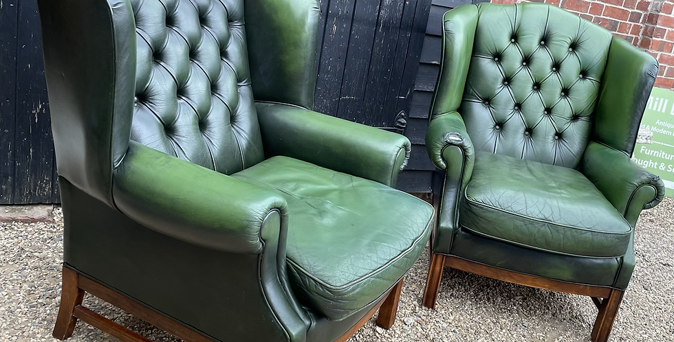 Pair Of Bottle Green Leather Wing Back Armchairs With Button Backs