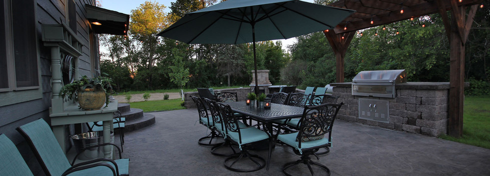 outdoor dining space and grill