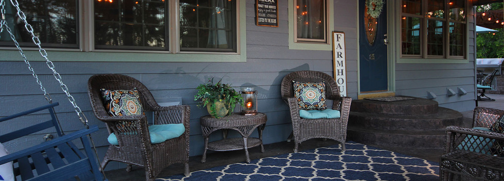 front porch with seating and swing