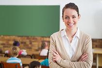 bigstock-pretty-teacher-smiling-at-came-