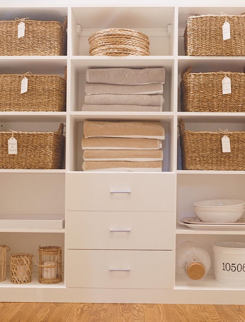 Labeled baskets in laundry room