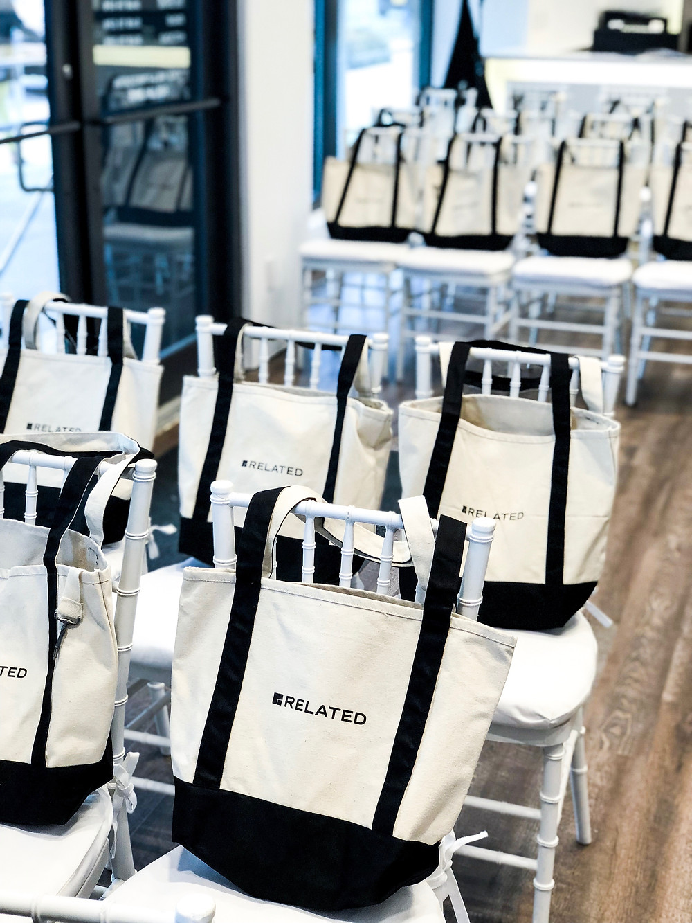 bags placed on event chairs
