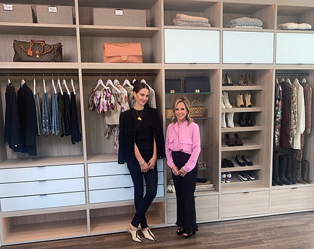 Lisa Jacobs with a client in front of an organized master closet by color