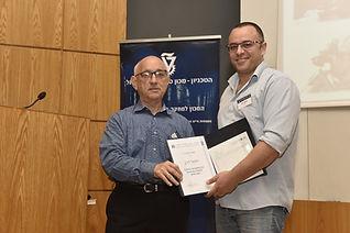 Professor Yaakov Nagel awarding Yehiel Dahan