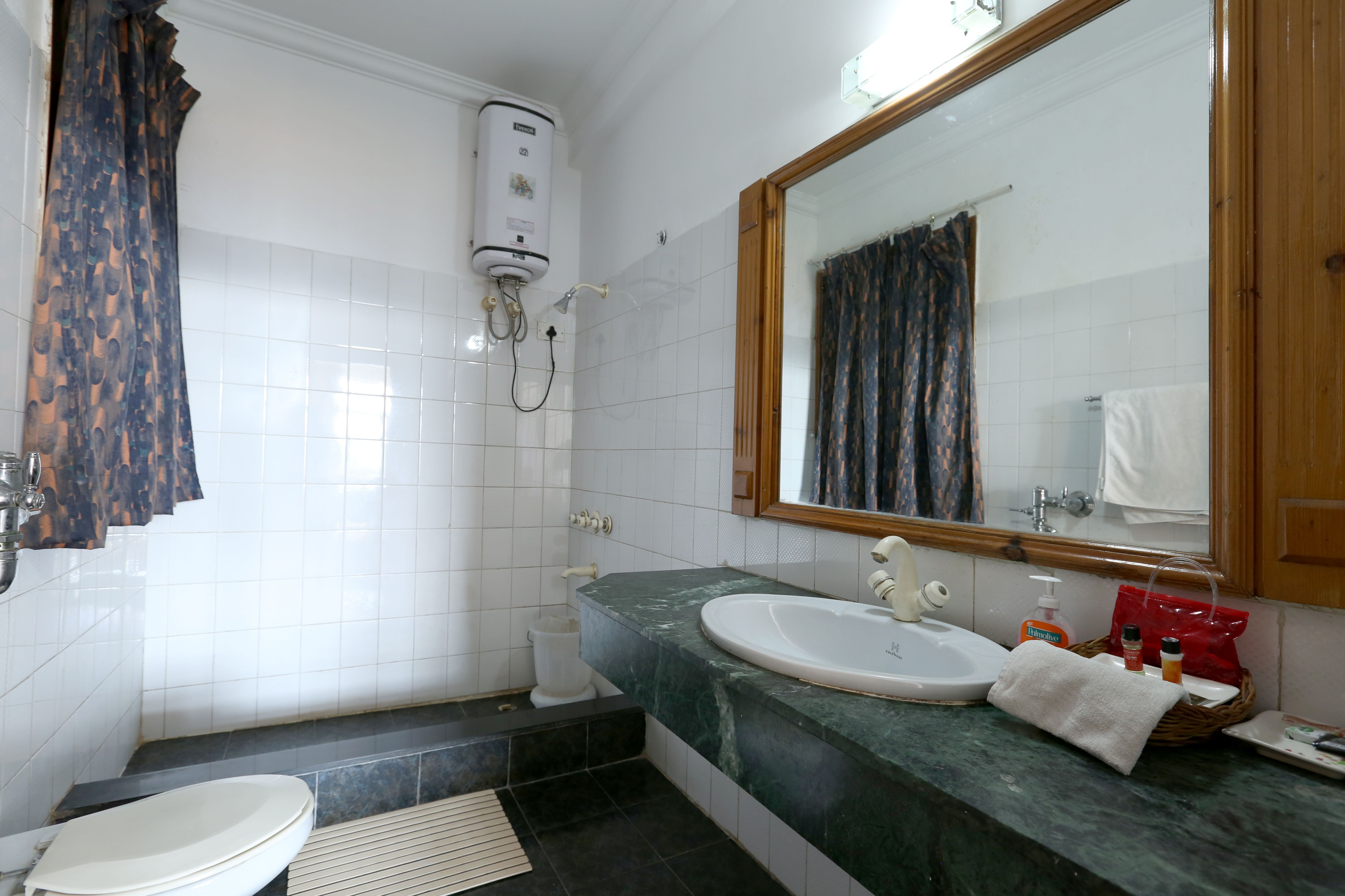 Room washrooms at Chail Residency