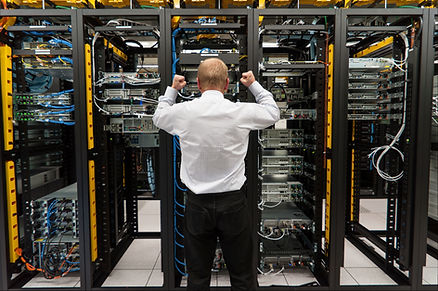 Man shaking fist at rack servers