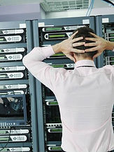 Distressed man in server room