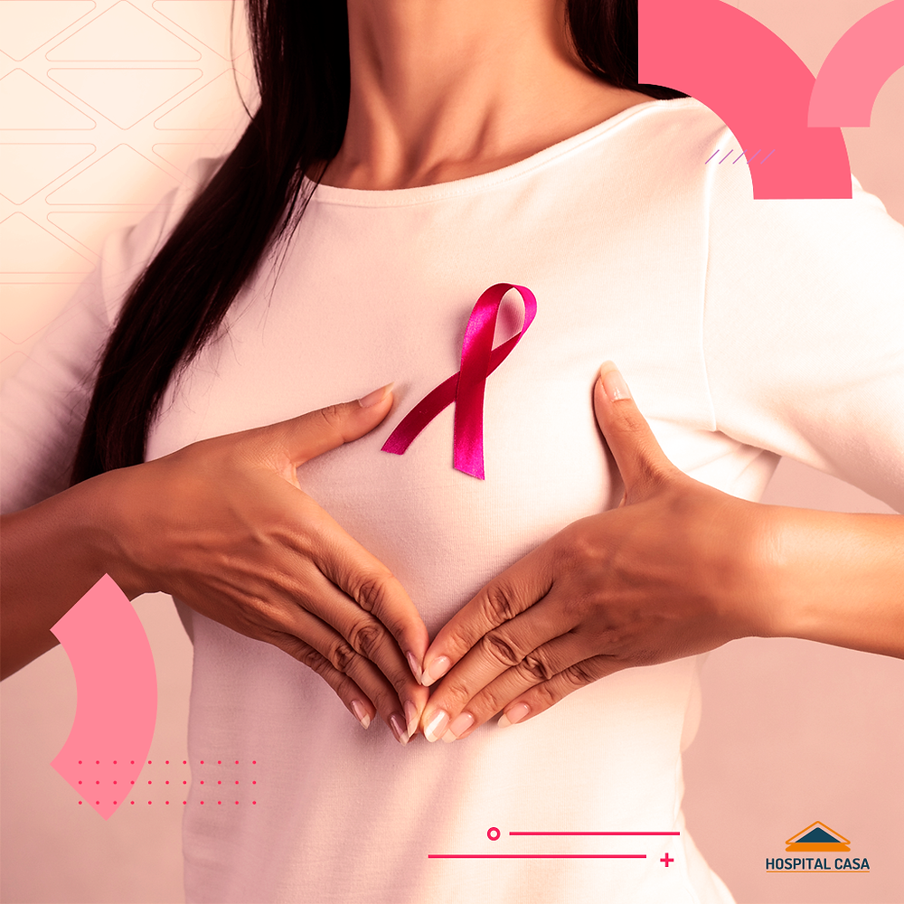 Mulher com o laço do outubro simbolizando a importância de fazer os exames preventivos para o câncer de mama.