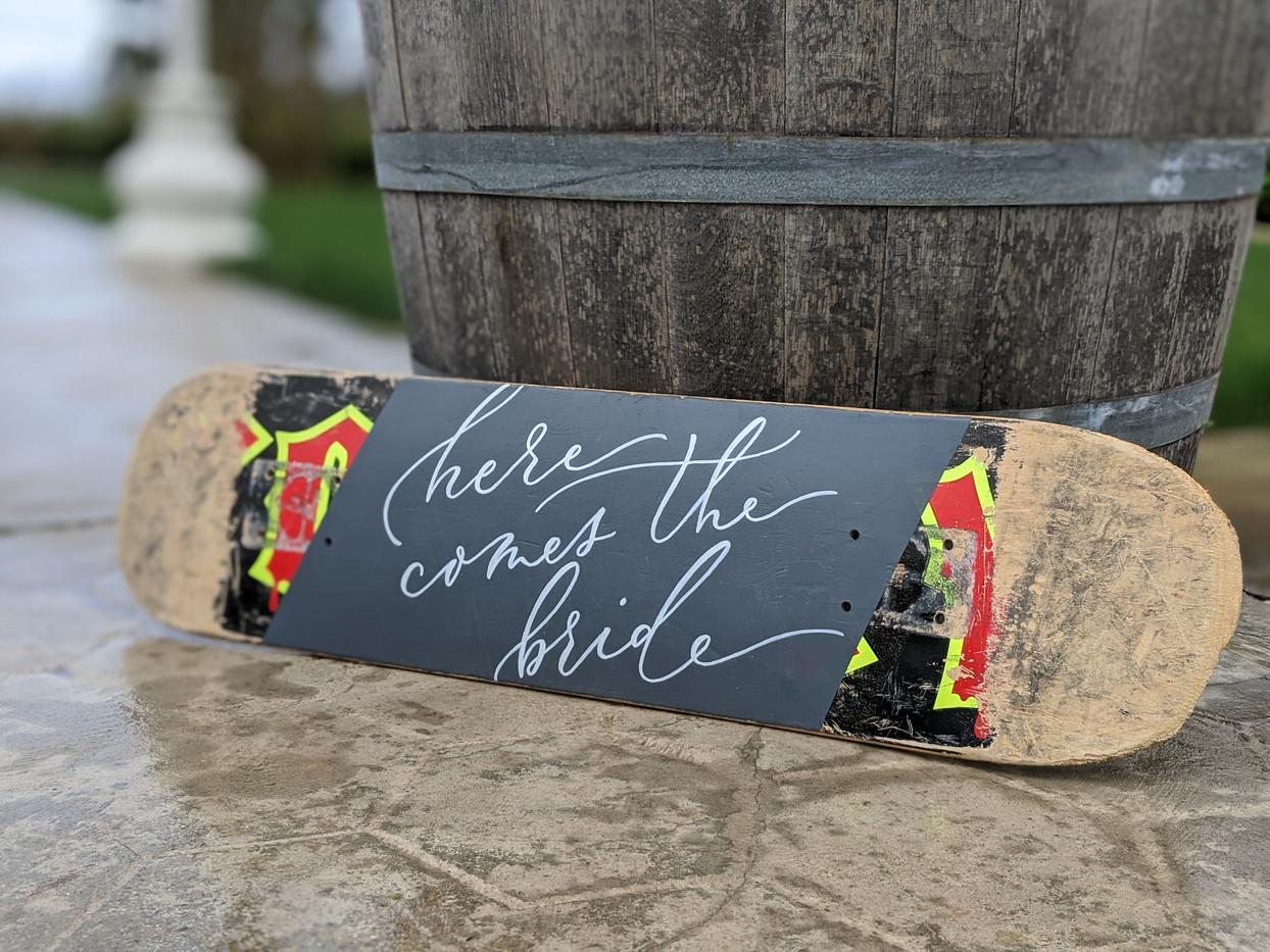 Ring bearer sign on skateboard deck