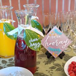 Mimosa bar sign and juice tags