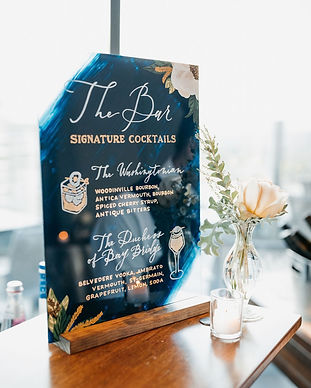Hand-lettered acrylic bar menu with illustrations
