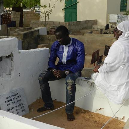 12. Captain's children on his grave in Touba.jpg