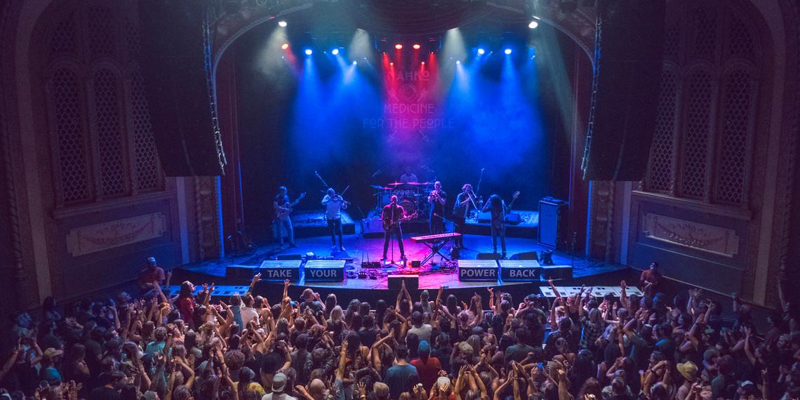crowd.handsup.litup.jpg