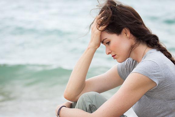 Dejected-girl-on-beach.jpg