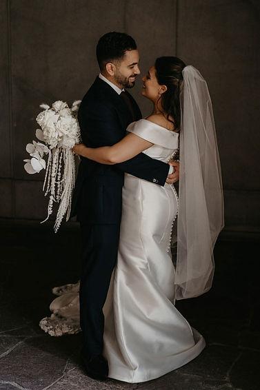 bride-and-groom-hugging-2_edited.jpg