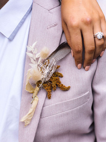 boutonniere-and-wedding-ring.jpg