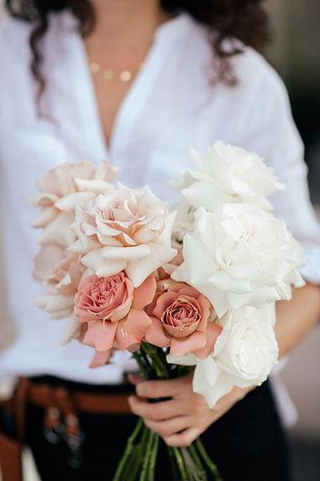 floral-designer-holding-rose-bouquet.jpg