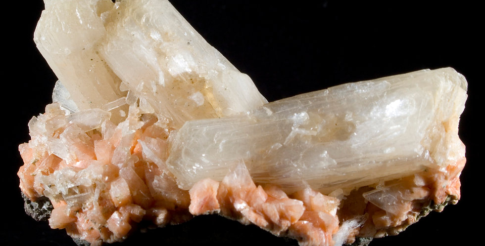 The unique orange Heulandite provides the canvas for complex, multi-generationalStilbite crystals to pop in contrast while t