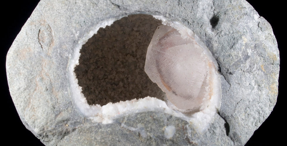 A natural Hematite Phantom Calcite crystal In Situ within a Basalt Geode. An amazing reminder of where the minerals and cryst