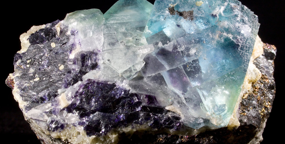 Multi-Hued Fluorite with stepped crystal facesminiature Quartz Scepters matrix containing veins of chalcopyrite