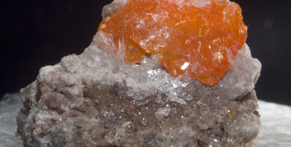 Wulfenite. Red Cloud Mine, La Paz County, Arizona, USA. A large, chunky, funky, 12 mm crystal of Wulfenite with some secondar