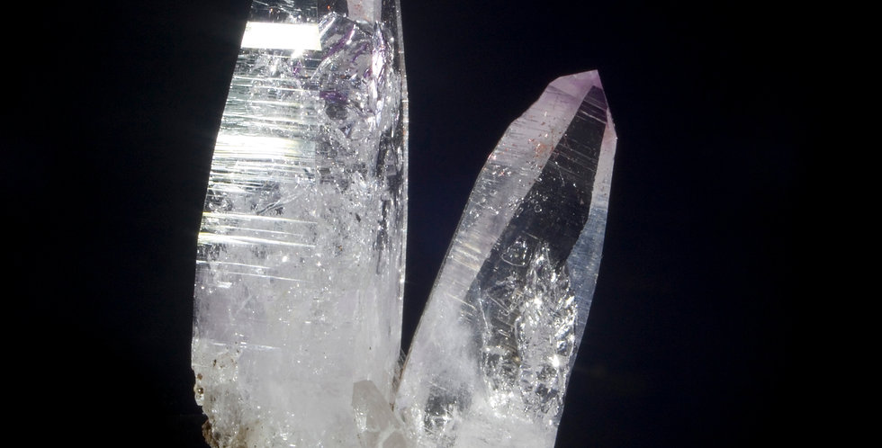 An excellent, aesthetic arrangement of Vera Cruz Amethyst with three large terminations accompanied by the smaller crystals.