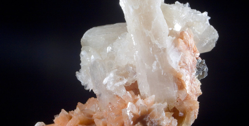 The unique orange Heulandite makes the white Stilbite clusters pop in contrast while the larger Stilbite crystals provide a c