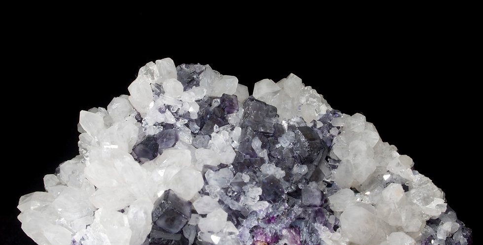 purple edged grey-clear crystals of Fluorite stand out against a matrix backdrop of milky Quartz scepters. Yindu Mine,