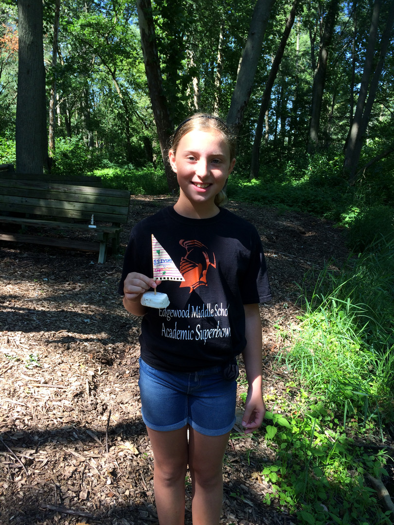 Student with their project in the great outdoors