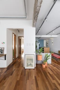 ap possamai | sala de estar e acesso à área íntima