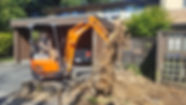 Person on excavator machine at construction job site