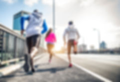 Three runners sprinting outdoors - Sport