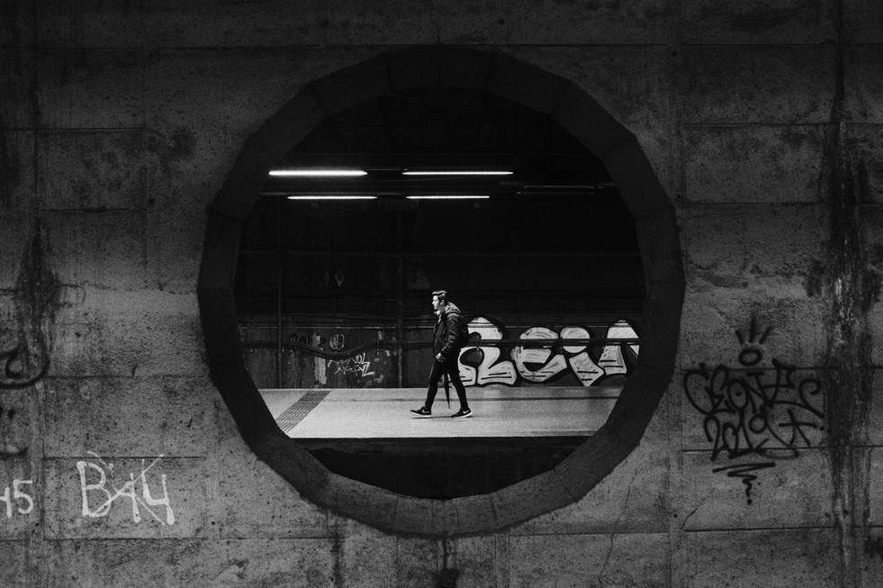 Street photo of a man on the metro stati