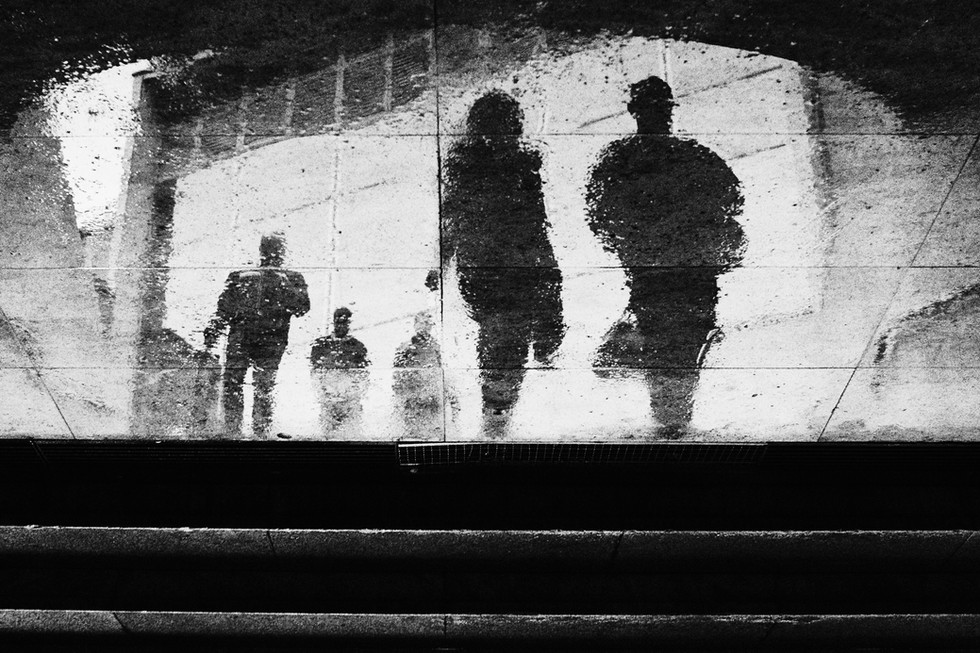Street photo of a puddle reflection with