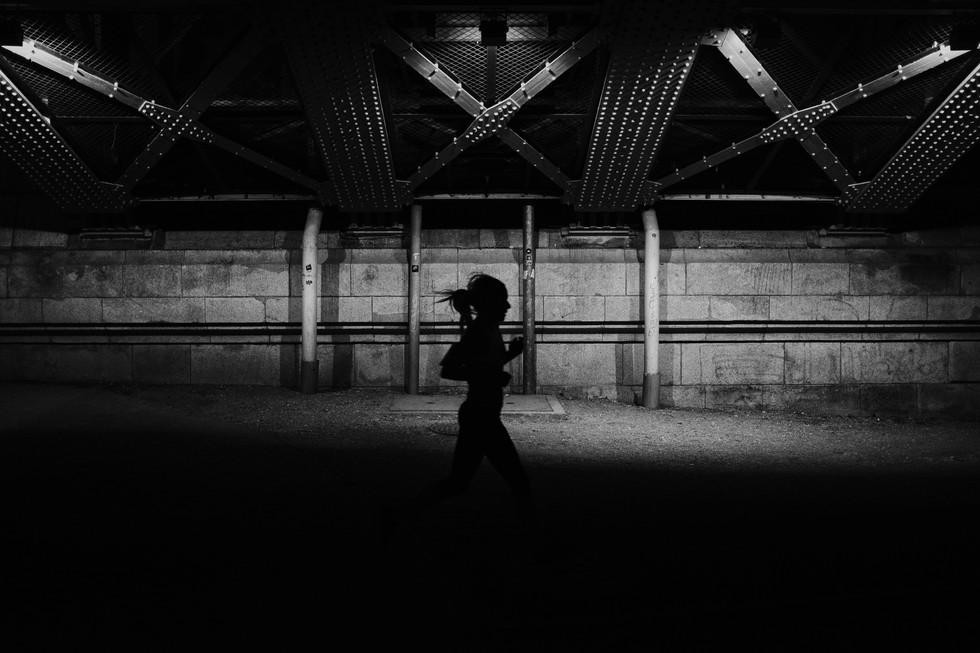 Street photo of a jogging woman running